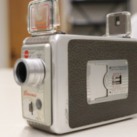 """<div style=""""text-align: center;""""><em><a href=""""http://collections.libraries.indiana.edu/IULMIA/exhibits/show/alan-lewis-collection"""">Return to Collection Home Page</a></em></div><br /> <br />Kodak Brownie Movie Camera Model II f/1.9"""