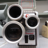 """<div style=""""text-align: center;""""><em><a href=""""http://collections.libraries.indiana.edu/IULMIA/exhibits/show/alan-lewis-collection"""">Return to Collection Home Page</a></em></div><br /> <br />Kodak Brownie Movie Camera Turret f/1.9"""