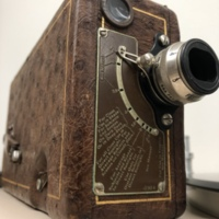 """<div style=""""text-align: center;""""><em><a href=""""http://collections.libraries.indiana.edu/IULMIA/exhibits/show/alan-lewis-collection"""">Return to Collection Home Page</a></em></div><br /> <br />Cin&eacute;-Kodak Model B (Ostrich Leather Version)"""