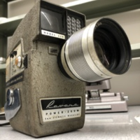"""<div style=""""text-align: center;""""><em><a href=""""http://collections.libraries.indiana.edu/IULMIA/exhibits/show/alan-lewis-collection"""">Return to Collection Home Page</a></em></div><br /> <br />Revere Eye-Matic Power Zoom Model 119"""
