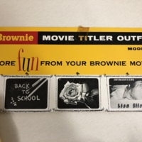 """<div style=""""text-align: center;""""><em><a href=""""http://collections.libraries.indiana.edu/IULMIA/exhibits/show/alan-lewis-collection"""">Return to Collection Home Page</a></em></div><br /> <br />Brownie Movie Titler Outfit - Model 1"""