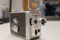 """<div style=""""text-align: center;""""><em><a href=""""http://collections.libraries.indiana.edu/IULMIA/exhibits/show/alan-lewis-collection"""">Return to Collection Home Page</a></em></div><br /> <br />Kodak Brownie Movie Camera Improved Model II f/2.3"""