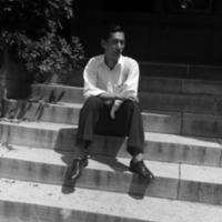 Chinese student on steps of Maxwell Hall