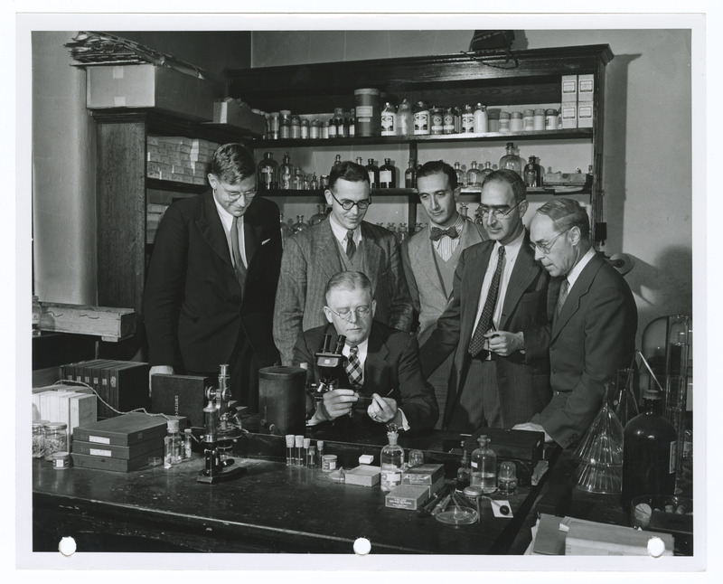 Group portrait of Hermann J. Muller, Tracy M. Sonneborn. Salvador E. Luria, Kenneth Mather, Norman Wingate Pirie, and Ralph E. Cleland in a lab at Indiana University, Bloomington