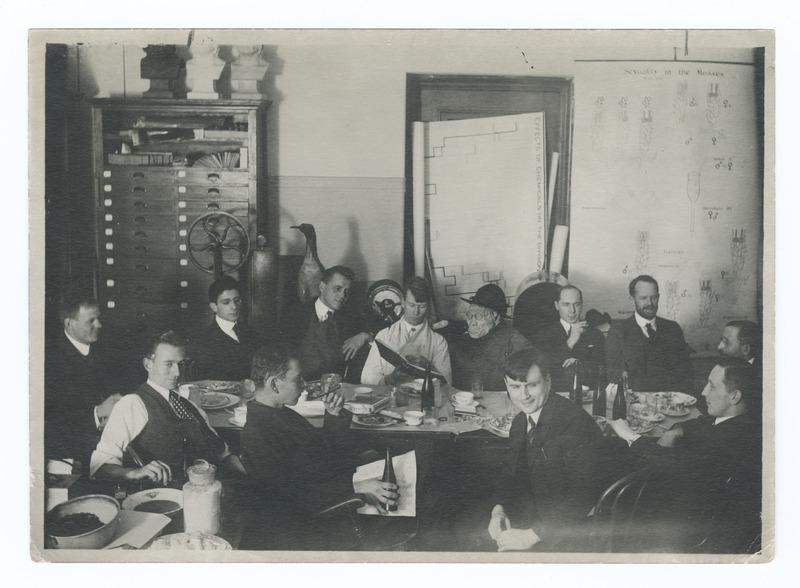"Luncheon party for Sturtevant, Columbia University, ""The flye room group"": H. J. Muller, Schrader, A. H. Sturtevant, Otto Mohr, Calvin B. Bridges, E. Anderson, Huettner, Thomas Hunt Morgan, Alexander Weinstein, the ""Caveman"""
