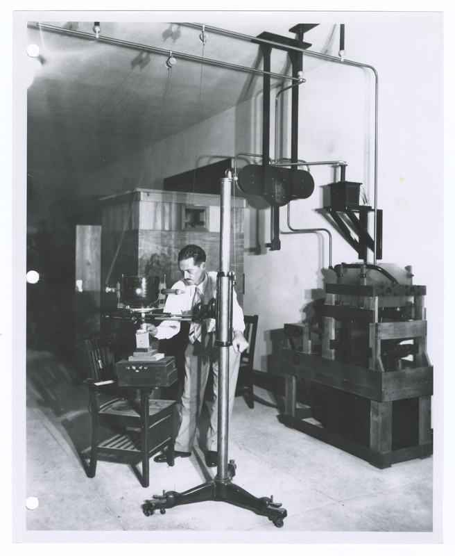 Pete Oliver working in a lab with an X-ray machine at the University of Texas