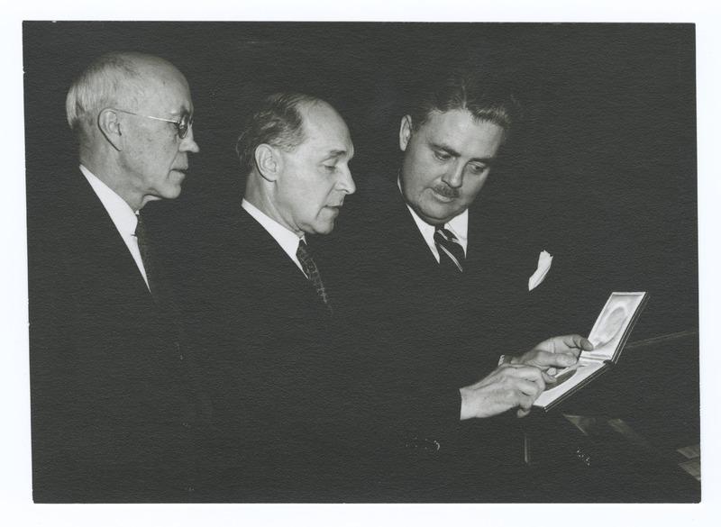 Herman J. Muller, Herman B. Wells, and Gernandus Payne with Nobel Prize