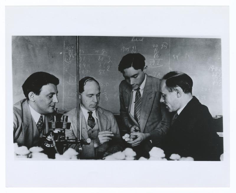 Solomon Levit, Hermann J. Muller, Carlos Offermann, and A. Israel Agol, in a lab (UT Austin presumably)