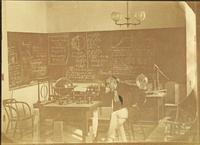 Photograph of Theophilus Wylie in his classroom for Natural Philosophy, Mechanics, Physics and Astronomy
